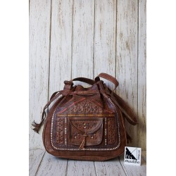 Engraved leather handbag