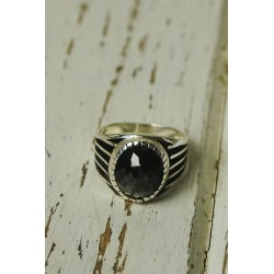 Antique silver ring with oval black stone