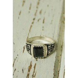 Antique silver ring with geometric design and black stone